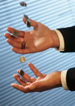 Hands Juggling Coins