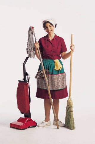 Maid With Vacuum and Broom