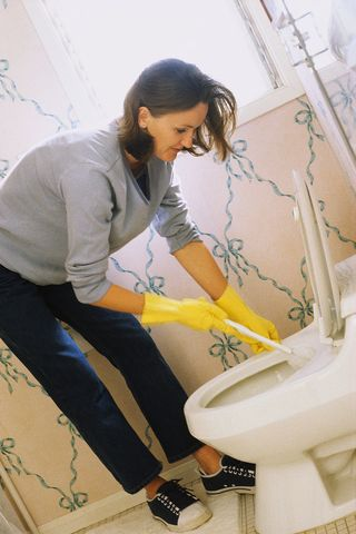 Woman Scrubbing Toilet