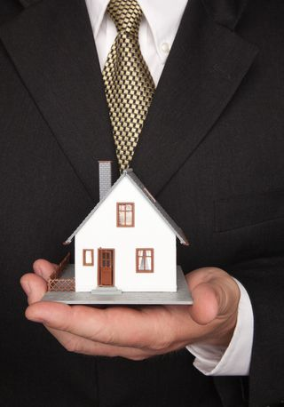 Man Holding MiniHouse.
