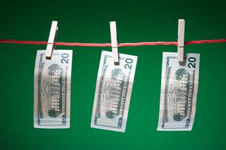 Dollar Bills hanging on clothesline