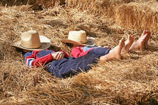 2 Kids Sleeping On Haystack
