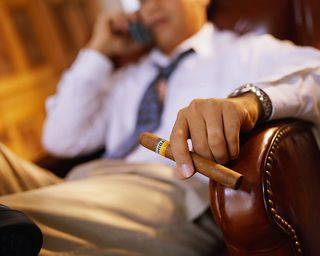 Guy in Leather Chair w Cigar